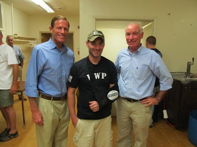 via p.twimg.com Micah inbetween U.S. Senator Richard Blumenthal and U.S. Congressman Joe Courtney